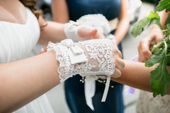 Beautiful bride wearing white lace gloves Royalty Free Stock Photos