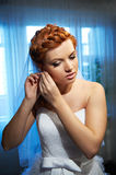 Beautiful Bride wears earrings Stock Photo