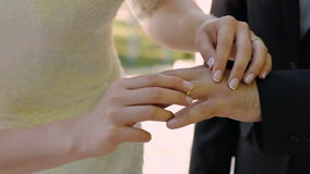 The beautiful bride wears the groom`s ring. Wedding ceremony.  stock video