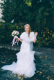 Beautiful bride with wedding bouquet of flowers roses Stock Images