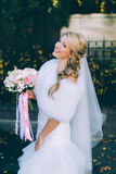 Beautiful bride with wedding bouquet of flowers roses Royalty Free Stock Images