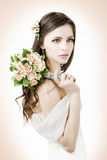 Beautiful bride with wedding bouquet Stock Images