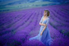 Beautiful Bride in wedding day in lavender field. Newlywed woman in lavender flowers. Beautiful Bride in wedding day in lavender field. Newlywed woman in royalty free stock photos