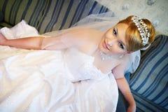Beautiful bride in wedding dress stock image