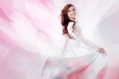 Beautiful bride in wedding dress,  abstract pink Royalty Free Stock Photos