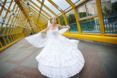 Beautiful bride in a wedding dress on bridge. Of Moscow river Royalty Free Stock Photo