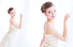 Beautiful bride in wedding dress. Bride in wedding dress about curtains Stock Images
