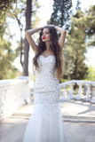 Beautiful bride in wedding dress. fashion outdoor photo of sexy Stock Image