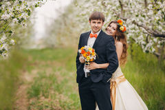 Beautiful bride in a wedding dress in the garden Stock Photo