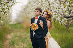 Beautiful bride in a wedding dress in the garden Stock Photography