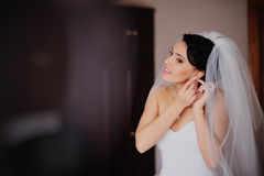 Beautiful bride in wedding dress getting ready Stock Images