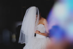 Beautiful bride in wedding dress getting ready Stock Photography
