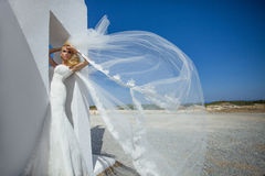 Beautiful bride in a wedding dress in greece with a long veil Royalty Free Stock Photo