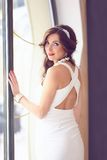 Beautiful bride, wedding dress and hairstyle Stock Photos