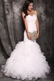 Beautiful bride in wedding dress holding decorative heart stock image