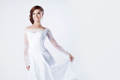 Beautiful bride in wedding dress, holds hem of Stock Photo