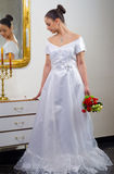 Young beautiful bride in wedding dress Stock Photo