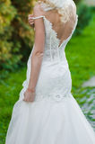 Beautiful bride in wedding dress near old castle. Blonde Royalty Free Stock Images