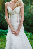 Beautiful bride in wedding dress near old castle. Blonde Stock Images