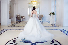 Beautiful bride. Wedding dress with open back. Luxurious light interior Stock Images