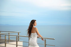 Beautiful Bride in wedding dress, outdoor portrait. Brunette ele Stock Photos