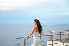 Beautiful Bride in wedding dress, outdoor portrait. Brunette ele Royalty Free Stock Photography