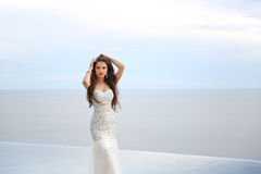 Beautiful Bride in wedding dress, outdoor portrait. Brunette ele Royalty Free Stock Images