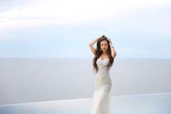 Beautiful Bride in wedding dress, outdoor portrait. Brunette ele Stock Photo