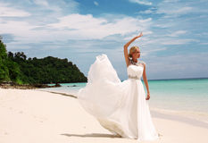 Beautiful bride in wedding dress posing on beautiful island in Thailand Stock Images
