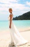 Beautiful bride in wedding dress posing on beautiful island in Thailand Stock Photos