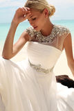 Beautiful bride in wedding dress posing on beautiful island in Thailand Royalty Free Stock Photography