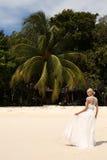 Beautiful bride in wedding dress posing on beautiful island in Thailand Stock Image