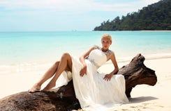 Beautiful bride in wedding dress posing on beautiful island in Thailand Stock Photography