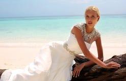 Beautiful bride in wedding dress posing on beautiful island in Thailand Royalty Free Stock Photo