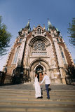 Beautiful bride in wedding dress preparing to ceremony in church. Walking back holding hands near old castle Royalty Free Stock Image