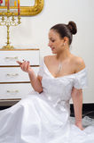 Bride looking at her wedding ring Stock Photos