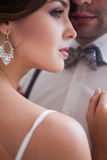 Beautiful bride in wedding dress, white background Stock Images