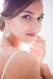Beautiful bride in wedding dress, white background Royalty Free Stock Image