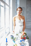 Beautiful bride in wedding dress, white background Stock Image
