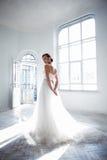Beautiful bride in wedding dress, white background Royalty Free Stock Photo