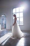 Beautiful bride in wedding dress, white background Stock Photo