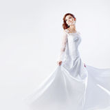 Beautiful bride in wedding dress, white background Stock Photo