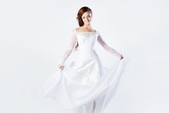 Beautiful bride in wedding dress, white background. Beautiful smiling woman in a wedding dress Royalty Free Stock Photography