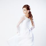 Beautiful bride in wedding dress, white background. Beautiful smiling woman in a wedding dress Stock Images
