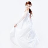Beautiful bride in wedding dress, white background. Beautiful smiling woman in a wedding dress Stock Photography