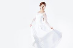 Beautiful bride in wedding dress, white background Royalty Free Stock Photo