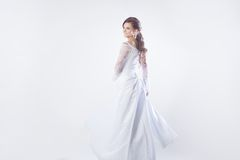 Beautiful bride in wedding dress, white background. Beautiful smiling woman in a wedding dress Royalty Free Stock Photos