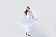 Beautiful bride in wedding dress, white background. Beautiful smiling woman in a wedding dress Stock Photos