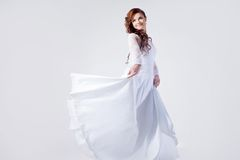 Beautiful bride in wedding dress, white background Royalty Free Stock Photos
