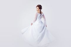Beautiful bride in wedding dress, white background Royalty Free Stock Images